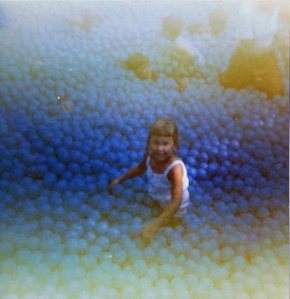 Me smiling up at my mom in the Ball Pit at Eagles Nest.